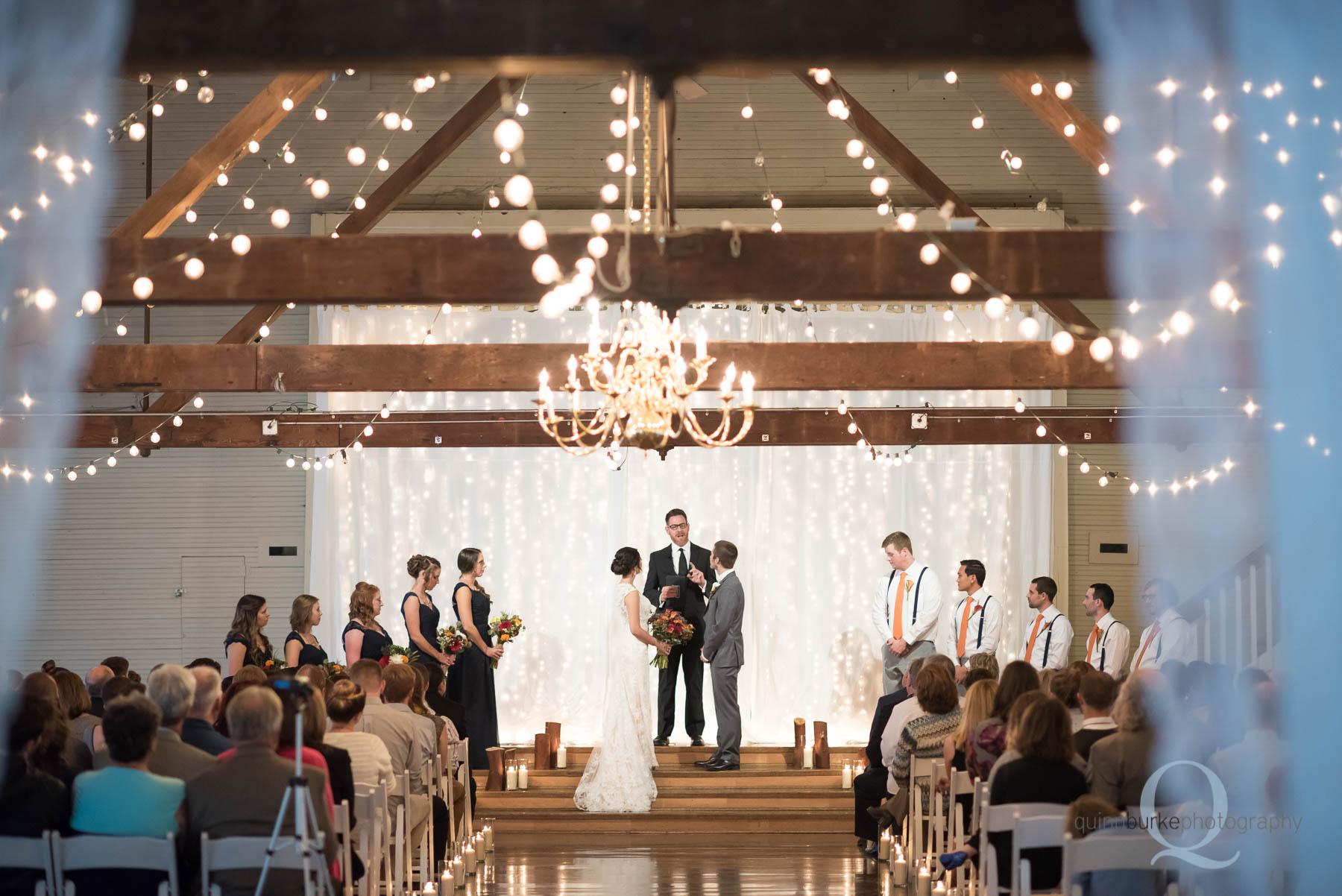 Green Villa Barn wedding ceremony in barn
