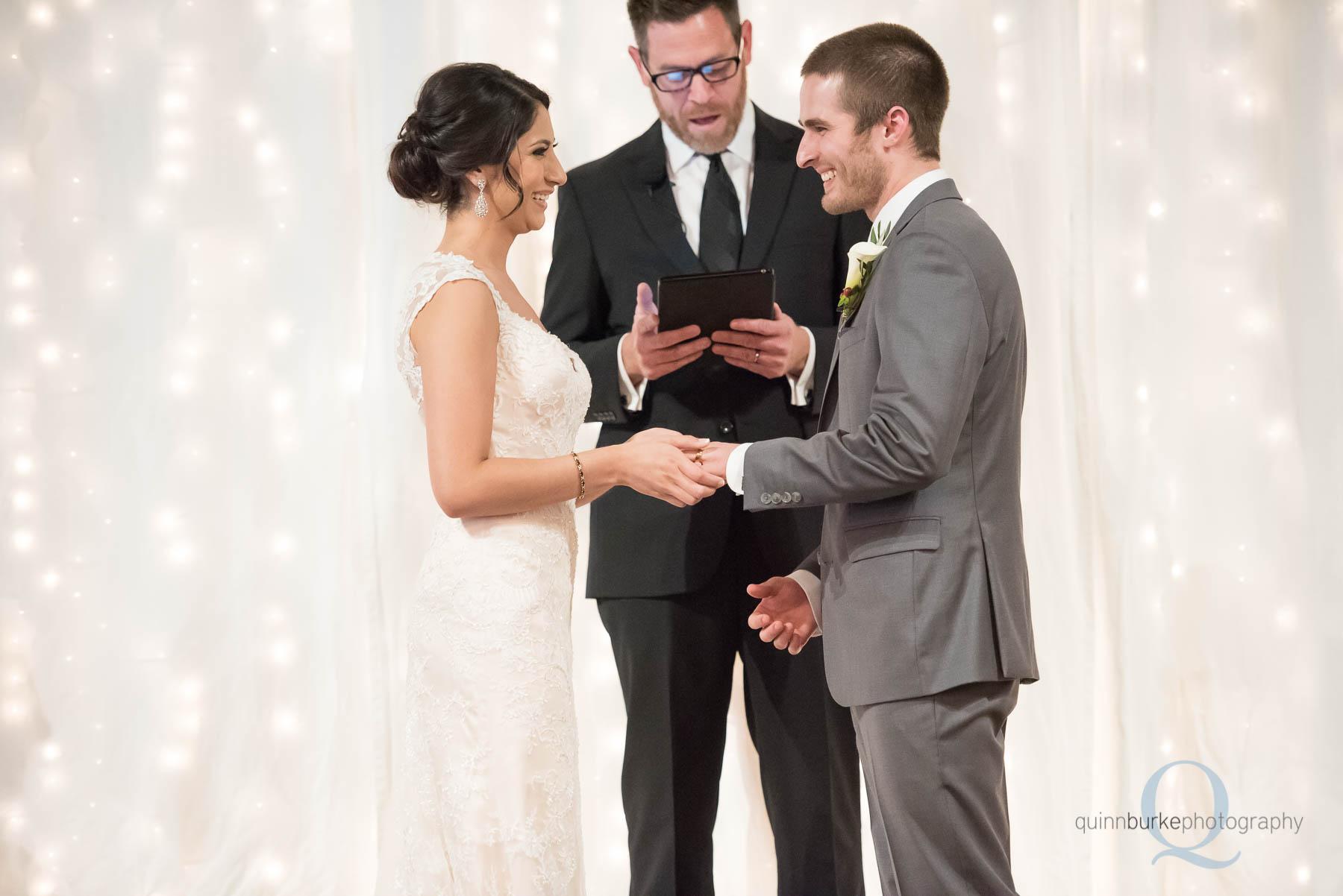 bride and groom holding hands wedding ceremony Green Villa Barn