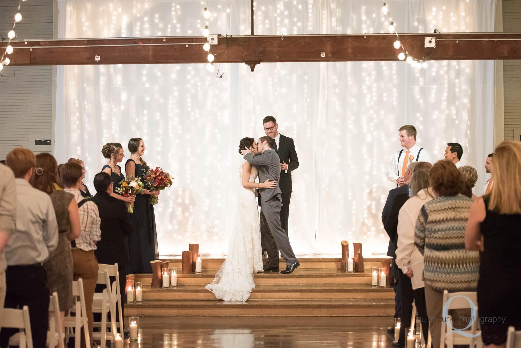 wedding ceremony first kiss at Green Villa Barn