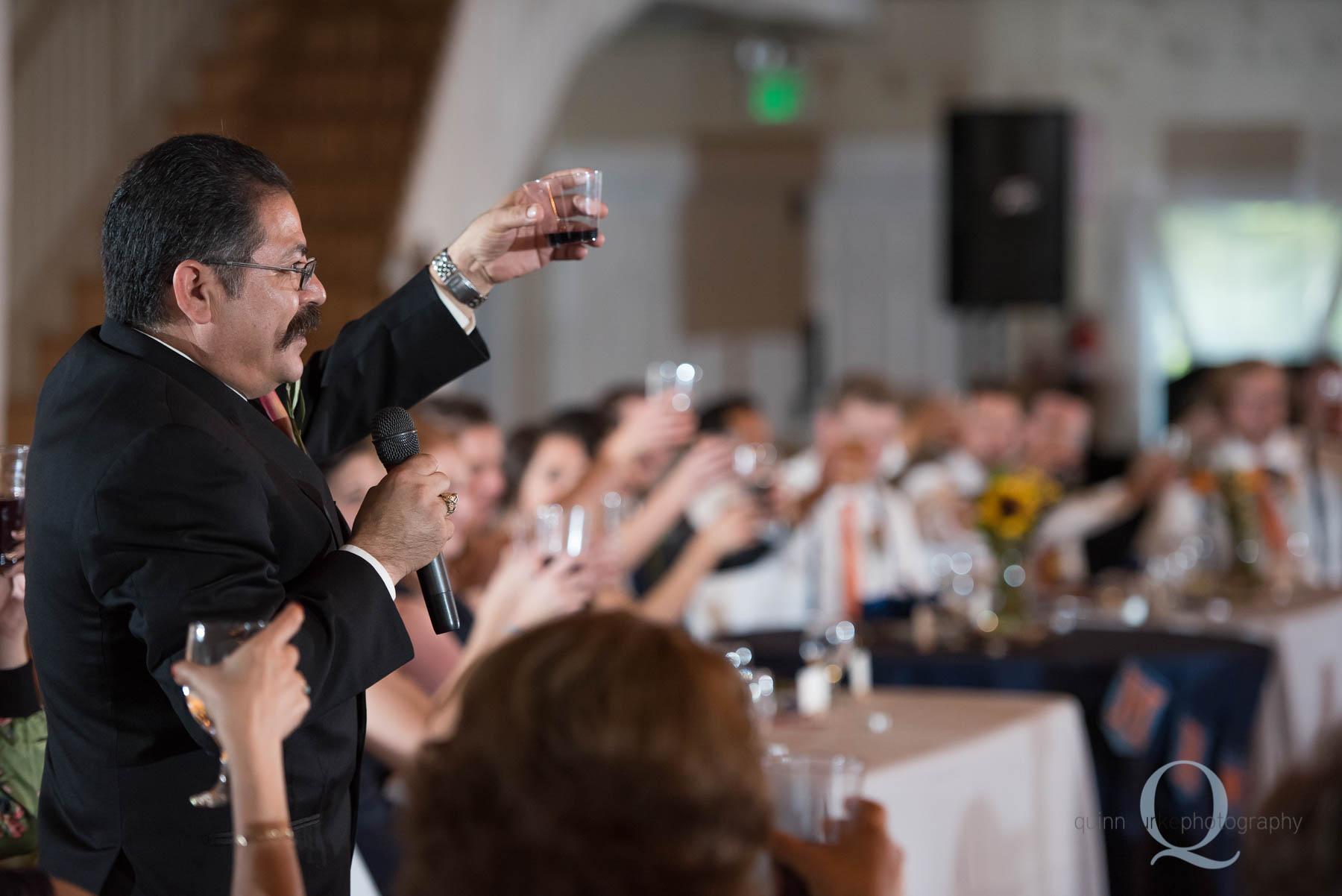dad toasts at wedding ceremony Green Villa Barn