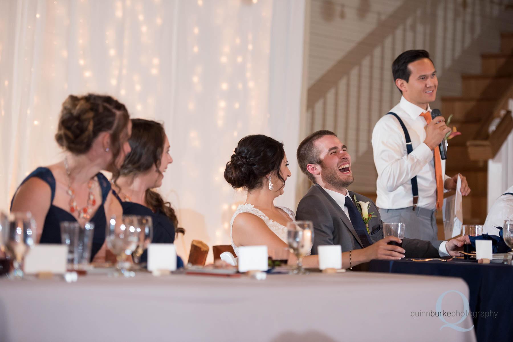 groomsmen toast during reception at Green Villa Barn