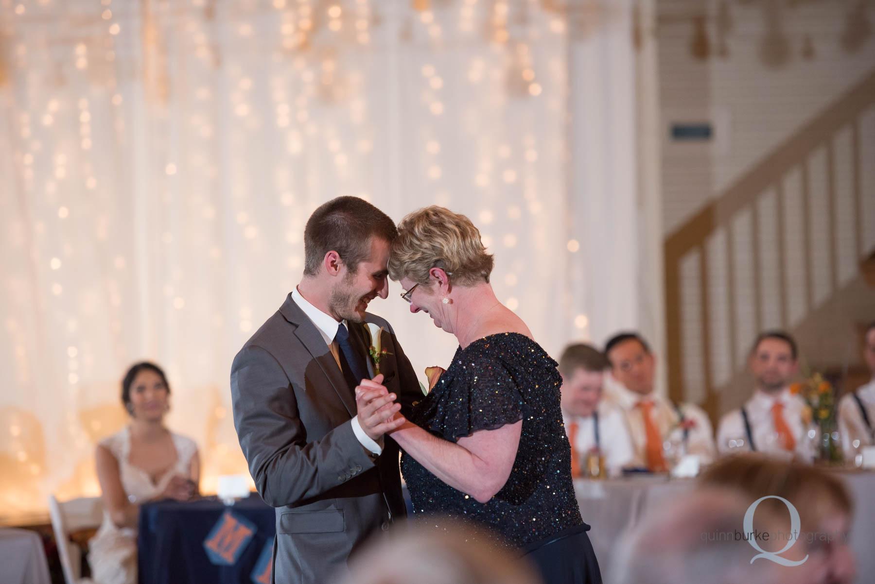 mother son groom dance during reception Green Villa Barn wedding