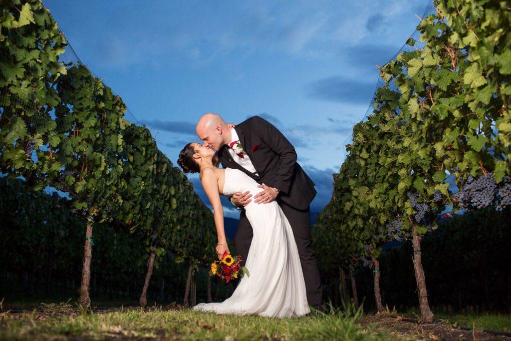 bride groom dusk dip kiss vineyard winery wedding oregon