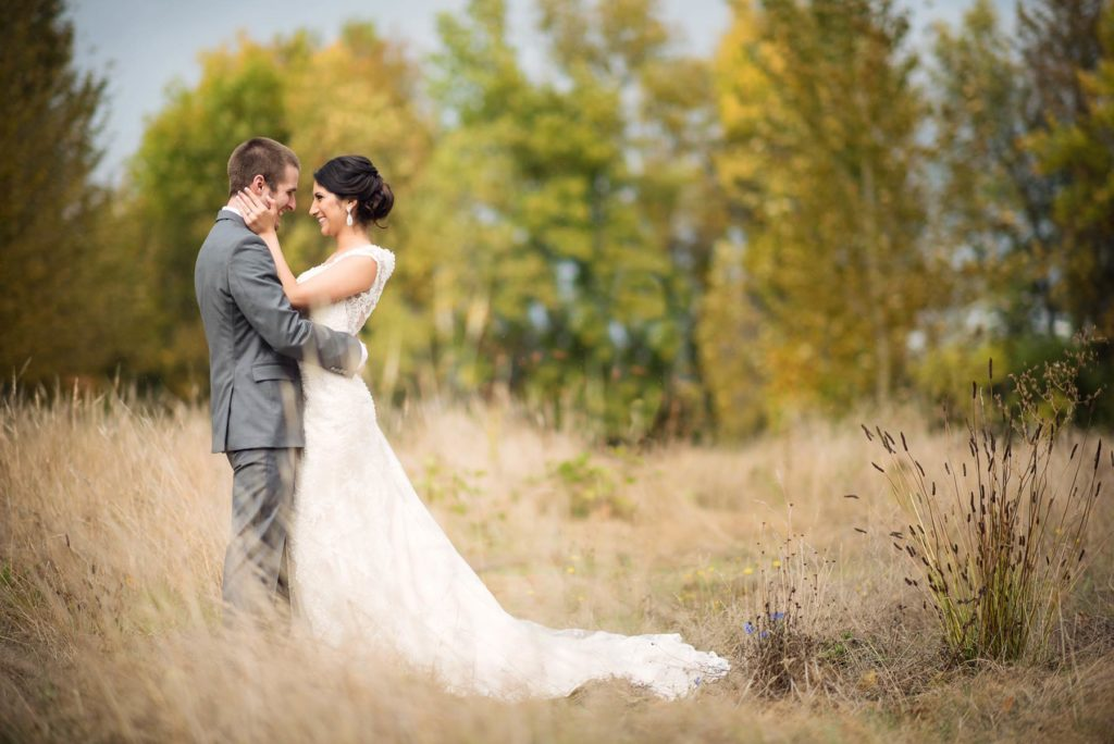 bride and groom portrait green villa barn wedding in field salem oregon