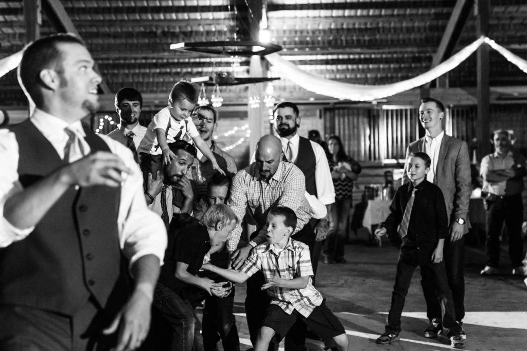 garter toss bend oregon wedding kids reaching for garter