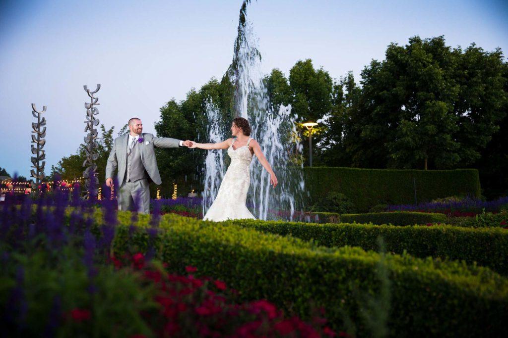 bride groom dancing oregon gardens wedding fountain