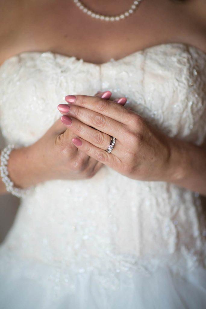 Bride wedding dress with ring close up detail green villa barn